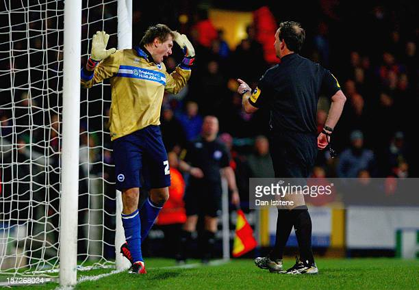 Tomasz Kuszczak of Brighton reacts as referee Mick Russell attempts to calm him down after awarding a penalty for a foul on Glenn Murray of Crystal...