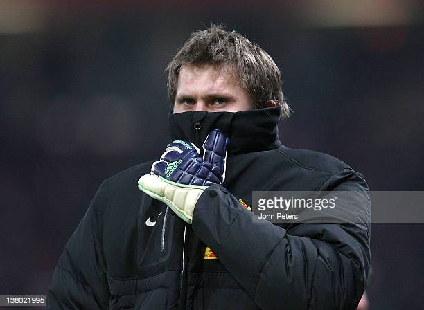Tomasz Kuszczak of Manchester United walks to the bench during the Barclays Premier League match between Manchester United and Stoke City at Old...
