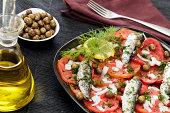 Tomato and fish salad