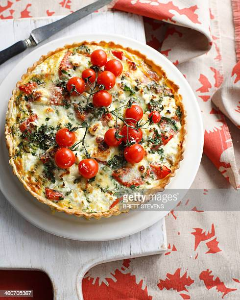 Tomato and red pepper tart with garnish