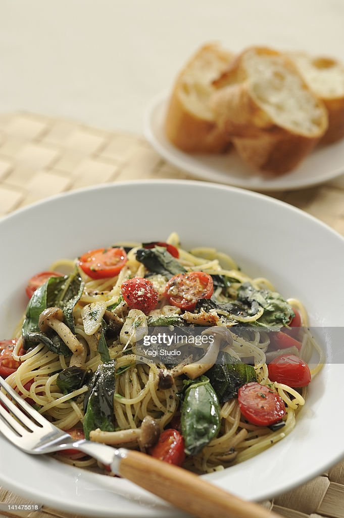 Tomato and the pasta of the basil : Stock Photo