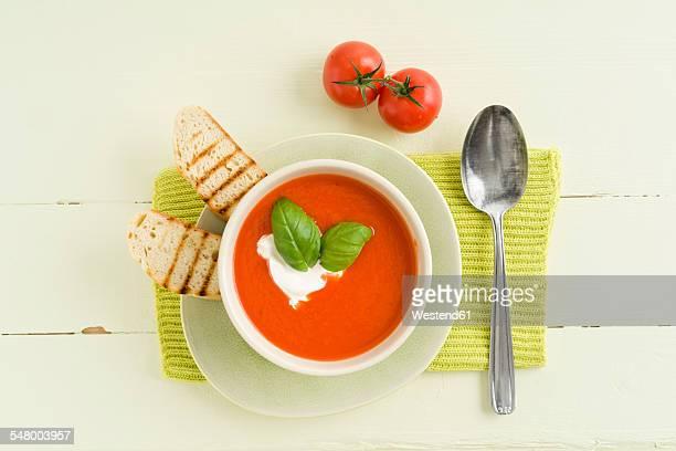 Tomato cream soup with baguette slice