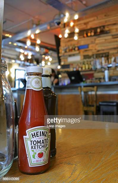 Tomato ketchup bottle on a pub table in East London