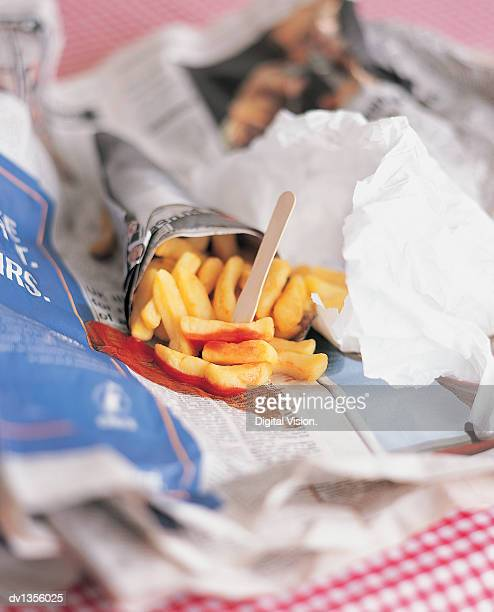 Tomato Ketchup on Chips Wrapped in a Newspaper