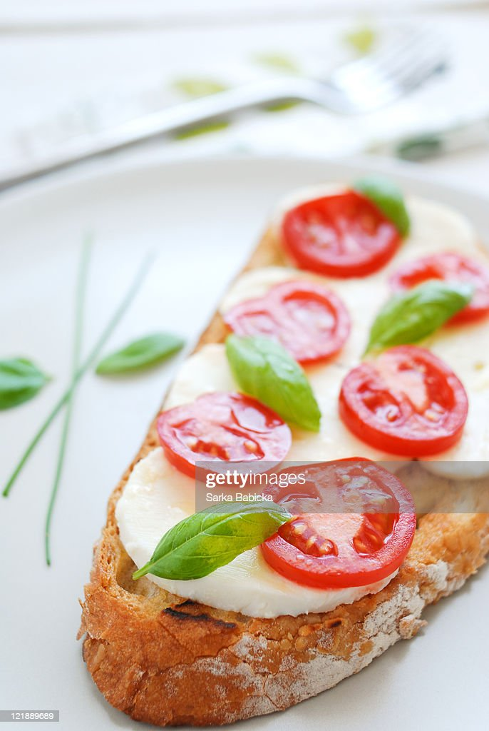 Tomato, mozzarella and basil bruschetta : Stock Photo