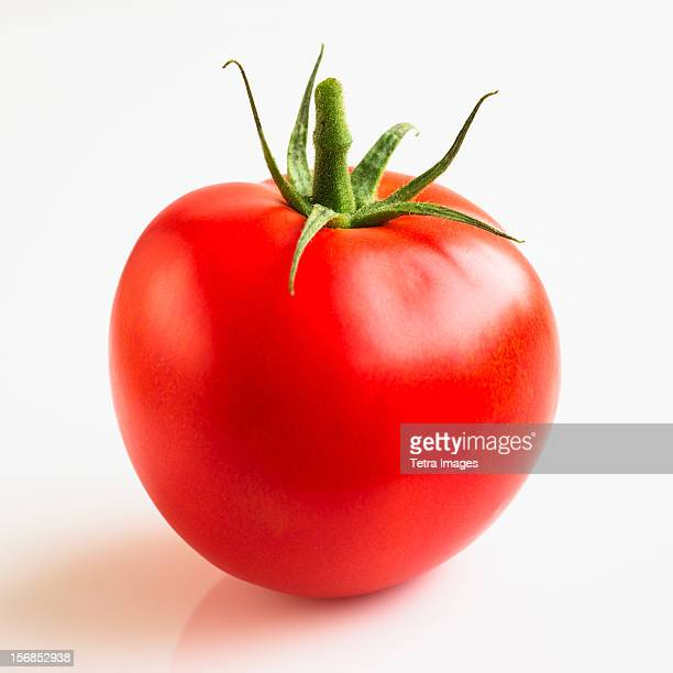 Tomato on white background, studio shot