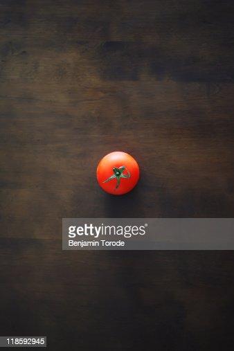 Tomato on wooden table : Stock Photo