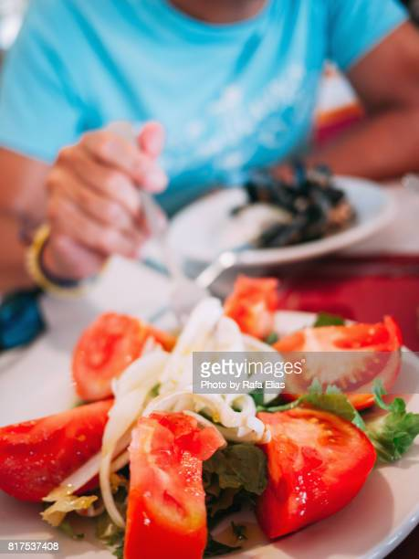 Tomato salad with onion and lettuce