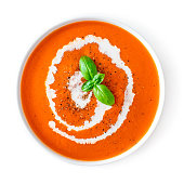 Tomato soup in a white bowl isolated on white background. Top view. Copy space. Traditional cold gazpacho soup. Spanish cusine'n