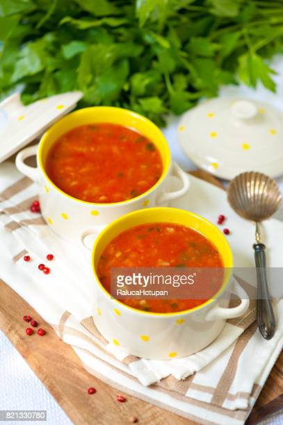 tomato soup in small porcelain bowls