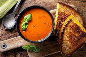 Delicious homemade tomato soup with a grilled cheese sandwich on rye.