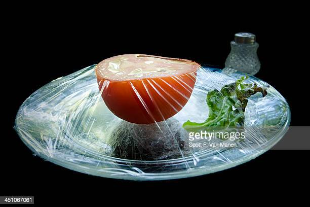 Tomato under plastic wrap