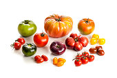 Collection of large variety of multi colored ripe tomatoes isolated on white background. DSRL studio photo taken with Canon EOS 5D Mk II and Canon EF 100mm f/2.8L Macro IS USM
