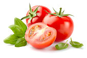 Tomato with basil in closeup
