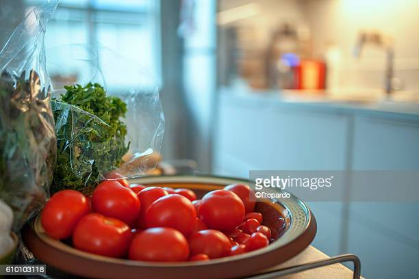 Tomatoes and a kitchen in the background