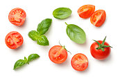 Tomatoes and basil leaves isolated on white background. Top view