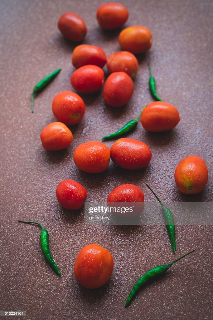 Tomatoes and Chillies : Stock Photo
