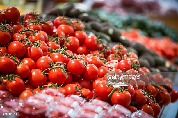 Tomatoes are displayed for sale in the produce section of a Coles supermarket operated by Wesfarmers Ltd in Sydney Australia on Tuesday Feb 18 2014...