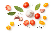 Tomatoes, garlic, bay leaves and peppercorn isolated on white background. Top view