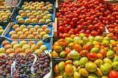 Tomatoes, grapes and peaches for sale at a market in Palermo