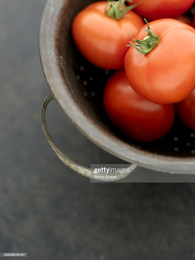 Tomatoes in bowl, close up, elevated view : Stock Photo