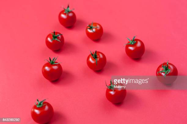 Tomatoes on bold red background. Bold Colours