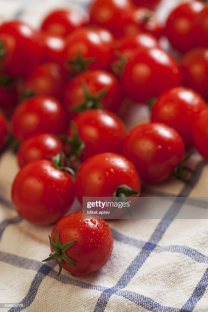 Tomatoes on towel : Stock Photo
