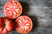 Tomatoes on a wooden table.
