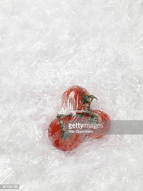 tomatoes tightly wrapped in cling film