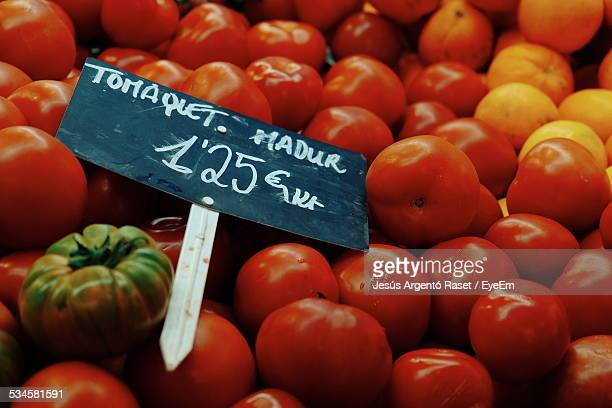Tomatoes With Price Tag For Sale In Market