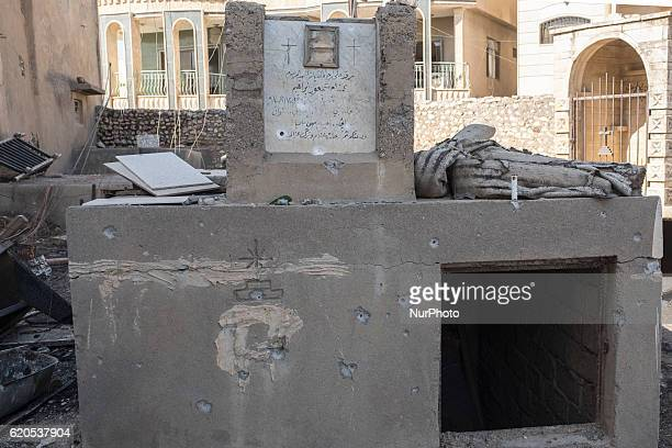 A tomb destroyed by bullets inside the christian cemetery of the Mart Shmony Syriac Orthodox church in Bartella on October 29 2016 Bartella village...