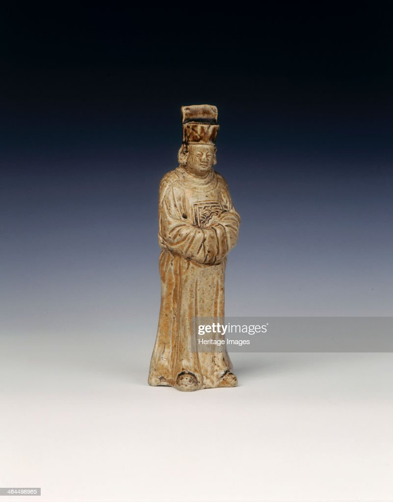 Tomb figure of an official Early Ming dynasty China 15th16th century Small transparent olive green glazed tomb figure moulded in the form of an...