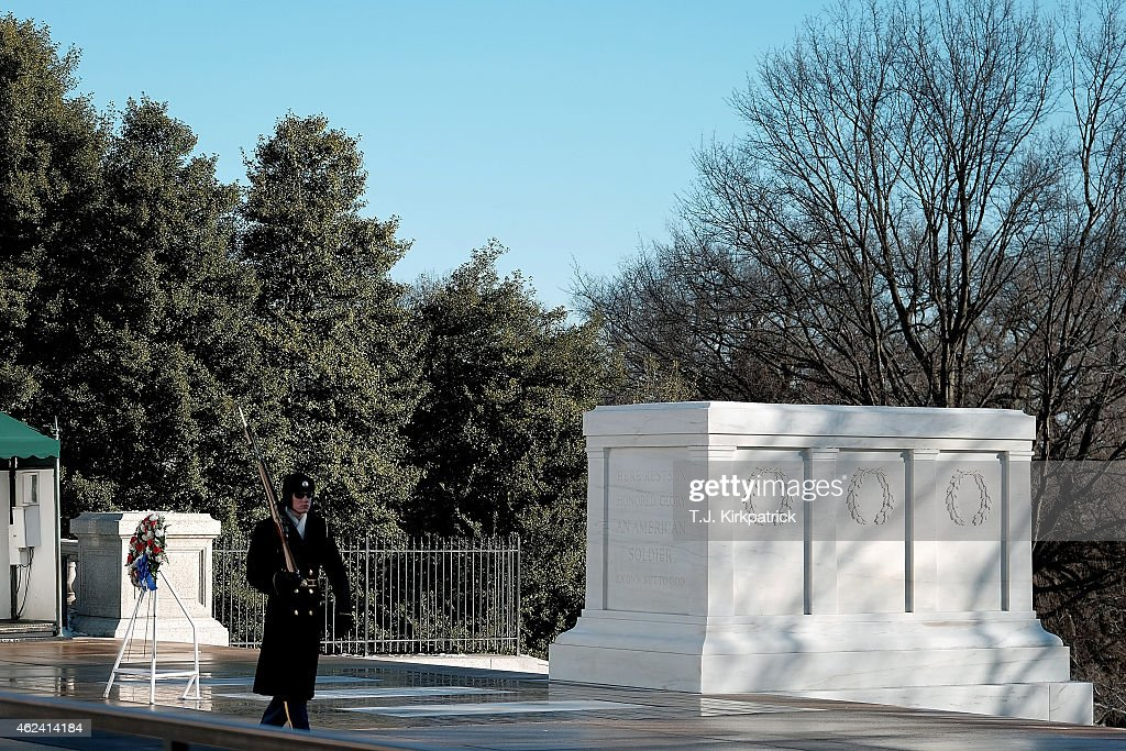 A tomb guard sentinel with The Old Guard the 3rd US Infantry Regiment stands watch over the Tomb of the Unknown Soldier after a wreathlaying ceremony...