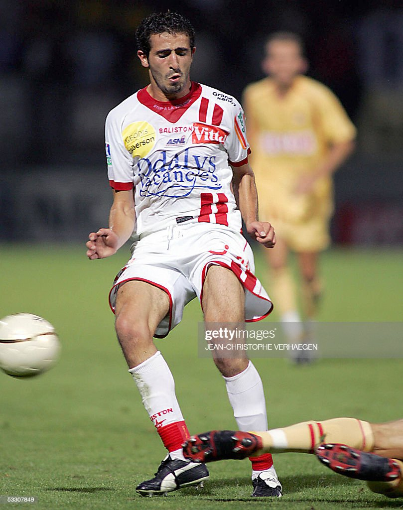 Nancy's midfielder Monscef Zerka is tackled by a Monaco's player during the French L1 football match NancyMonaco at the Marcel Picot Stadium 30 July...