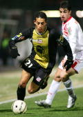 Nancy's midfielder of Uruguay Carlos Adrian Sarkisian vies with Ajaccio's midfielder Kamel Chafni during the French League 1 football match at Marcel...