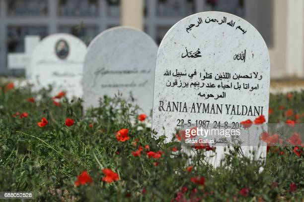 A tombstone at the grave of Rania Ayman Yaldani lies among graves that according to the cemetery caretaker are the graves of migrants who died while...