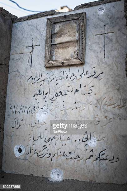 A tombstone destroyed by bullets inside the christian cemetery of the Mart Shmony Syriac Orthodox church in Bartella on October 29 2016 Bartella...