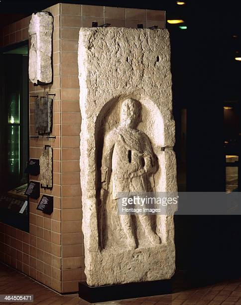 Tombstone of Vivius Marcianus Limestone tombstone with the fulllength figure of a centurion holding a staff in his right hand and perhaps a scroll in...