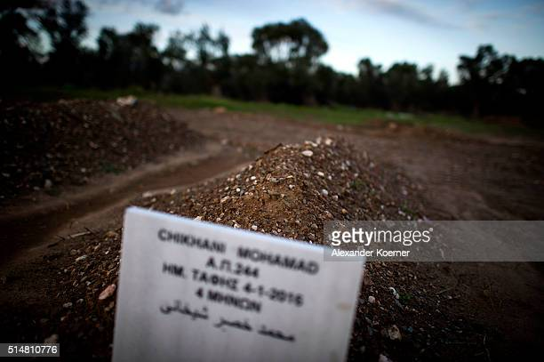 A tombstone sits on a grave of a migrant who died during the attempt to reach the Island of Lesbos at a newly built cemetery on March 11 2016 in Kato...
