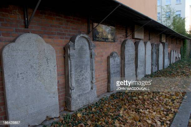 Tombstones are on display October 31 2013 against a wall of Berlin's oldest Jewish cemetery in the German capital's district of Mitte Dating back to...