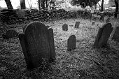 Tombstones in a small rural cemetary looks scary, black and white