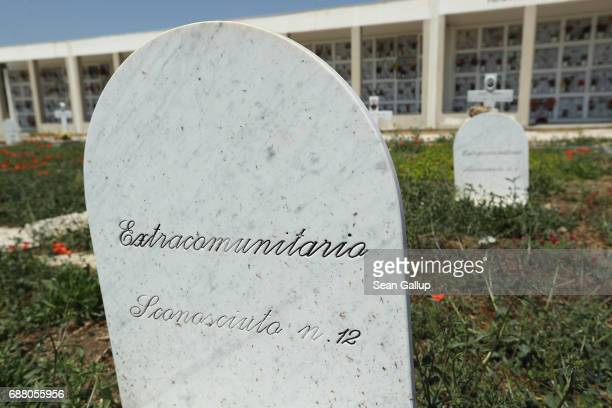 Tombstones including one that reads 'Unknown Nr 12' stand at graves that according to the cemetery caretaker are the graves of migrants who died...