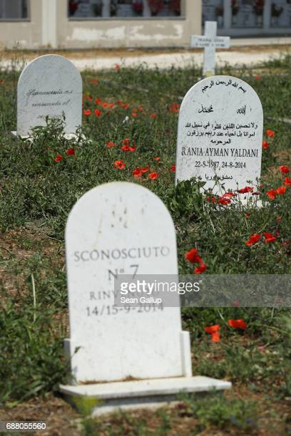 Tombstones stand at graves that according to the cemetery caretaker are the graves of migrants who died while trying to reach Italy on the island of...