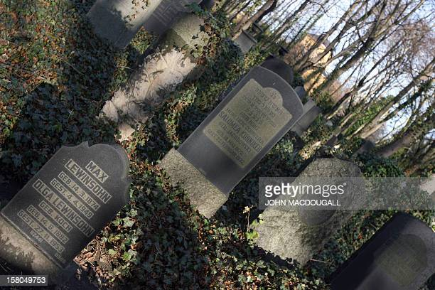 Tombstones stand in Berlin's Jewish cemetery in Weissensee 07 December 2006 Authorities are hoping the largest Jewish cemetery in Europe much of it...