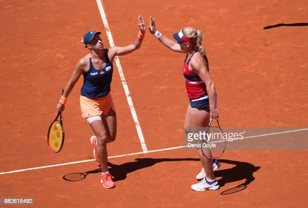 Tomea Babos of Hungary celebrates with Andrea Hlavackova of Czech Republic after winning a point against YungJan Chan of Teipei and Martina Hingis of...