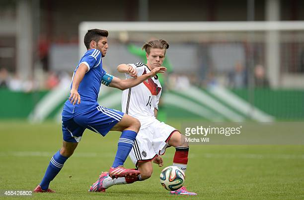 Tomer Altman of Isreal and Dzenis Burnic of Germany compete for the ball during the KOMM MIT tournament match between U17 Germany and U17 Israel on...