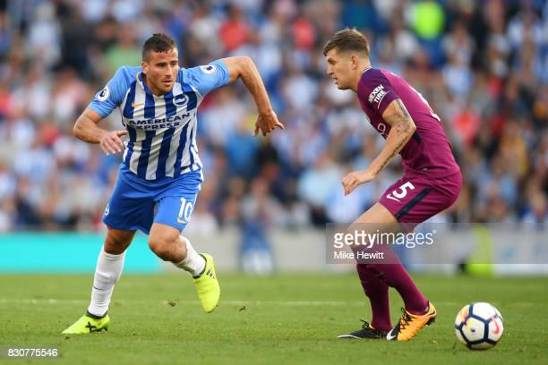 Tomer Hemed of Brighton and Hove Albion attempts to get past John Stones of Manchester City during the Premier League match between Brighton and Hove...