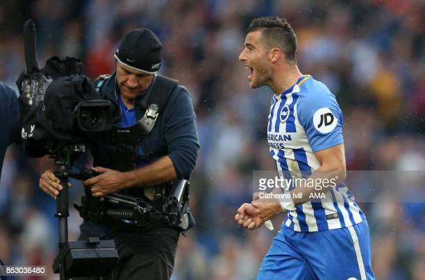 Tomer Hemed of Brighton and Hove Albion celebrates for the television camera after the Premier League match between Brighton and Hove Albion and...