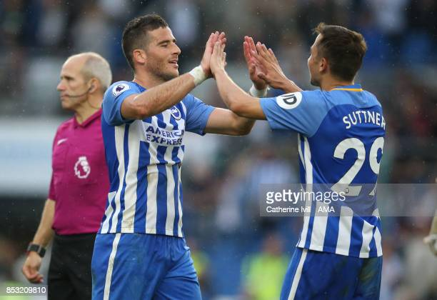 Tomer Hemed of Brighton and Hove Albion celebrates with Marus Suttner of Brighton and Hove Albion during the Premier League match between Brighton...