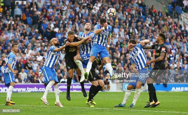 Tomer Hemed of Brighton and Hove Albion heads clear during the Premier League match between Brighton and Hove Albion and Newcastle United at Amex...